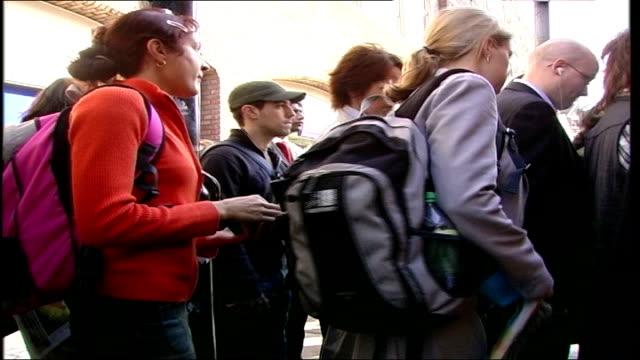 South West Trains strike Mortlake Station Vars passengers boarding bus outside station