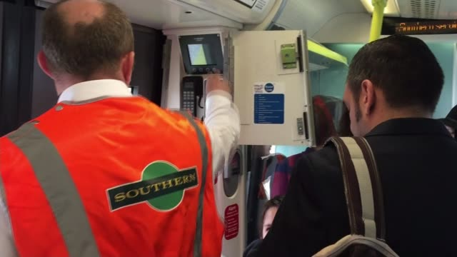 southern rail 5-day strike begins; england: london: int train train carriage doors closing passengers sat in train carriage as along woman reading... - newspaper strike stock videos & royalty-free footage