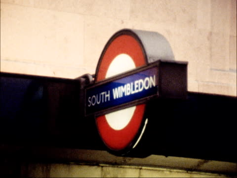 traffic congestion around london england london buildings and roads as traffic rl / wimbledon sign for south wimbledon tube station pull out queue... - 1979 stock videos and b-roll footage