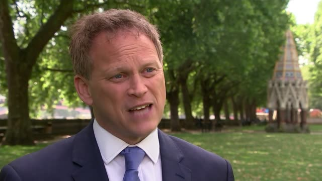 theresa may responds to govia thameslink and northern chaos city thameslink ext thameslink train along leaving station people seated inside... - grant shapps stock videos and b-roll footage