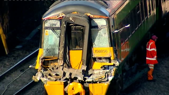 train collides with collapsed footbridge; england: leicestershire; barrow upon soar: ext rescue workers around derailed train which collided with... - footbridge stock videos & royalty-free footage