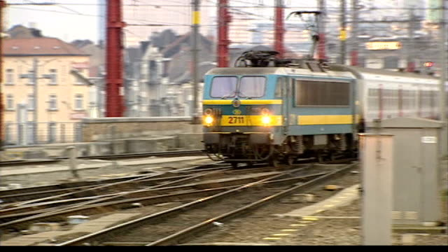 train fares to rise; belgium: brussels: gare du midi : belgian railways trains along large track system outside station int passengers boarding trains - railway track stock videos & royalty-free footage