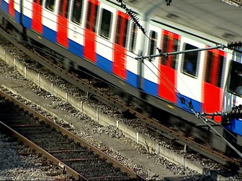 trainlines into paddington; england: london: paddington: ext various good general views from bridge over train tracks, london underground trains... - railway signal stock videos & royalty-free footage