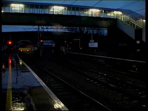 trains at northampton station; england: northampton: northampton station: ext / raining silverlink county train at platform and pulling away /... - northampton england stock videos & royalty-free footage