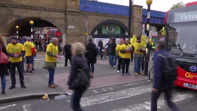 Trains at Waterloo / RMT picket Varuious shots striking workers outside Waterloo Station entrance with placards and leaflets