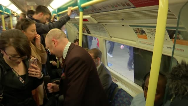 transport for london launches priority seating week england london ext james mcnaught along platform at railway station mcnaught boarding train close... - commuter train stock videos & royalty-free footage