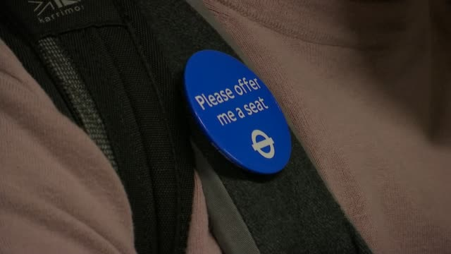 vídeos y material grabado en eventos de stock de transport for london launches priority seating week int amit patel interview sot close shot of patel wearing badge 'please offer me a seat' people... - insignia accesorio personal