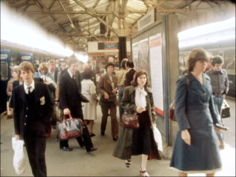 transport minister joins commuters on their way to work; england: london: wimbledon: ext norman fowler talking to british rail staff train into... - physical activity stock videos & royalty-free footage