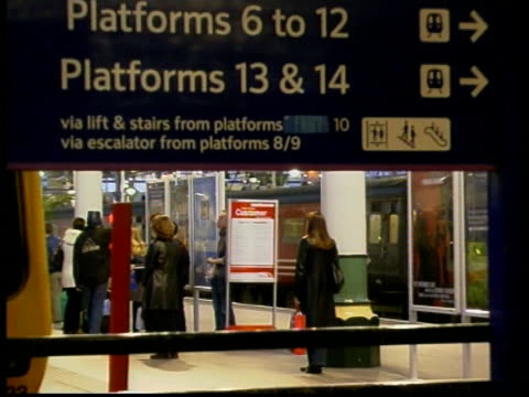 failure to meet timetable deadline itn england unidentified commuters past along station platform gvs passengers thru ticket barriers ms virgin... - information sign stock videos & royalty-free footage