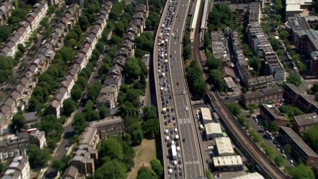 tube strike begins across london underground network; lib air view - aerial of traffic at a standstill on major road air view - aerial of tube trains... - major road点の映像素材/bロール