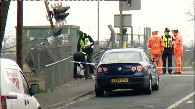 Two men killen in Grimsby level crossing accident ENGLAND Lincolnshire Grimsby Great Coates EXT Various of police officers and accident investigators...