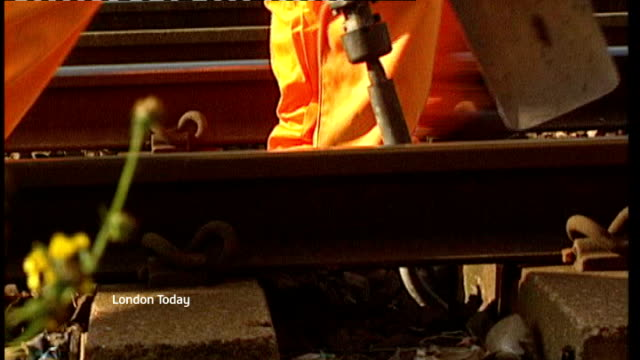 rail union says costcutting measures are putting passenger safety at risk various dates rail workers repairing damaged track train along down track... - itv london lunchtime news stock-videos und b-roll-filmmaterial
