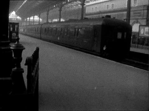 victoria station out of action; england: london: victoria station: int gv entrance to platform empty / notice 'service suspended' to train / lms... - railway junction stock videos & royalty-free footage