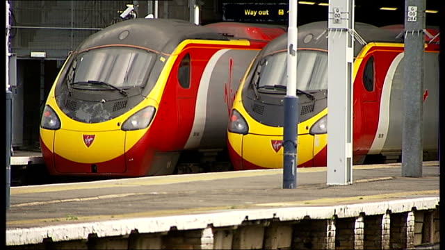 virgin re-awarded west coast mailine franchise on a temporary basis; virgin pendolino trains at platform virgin train leaving station - franchising stock videos & royalty-free footage