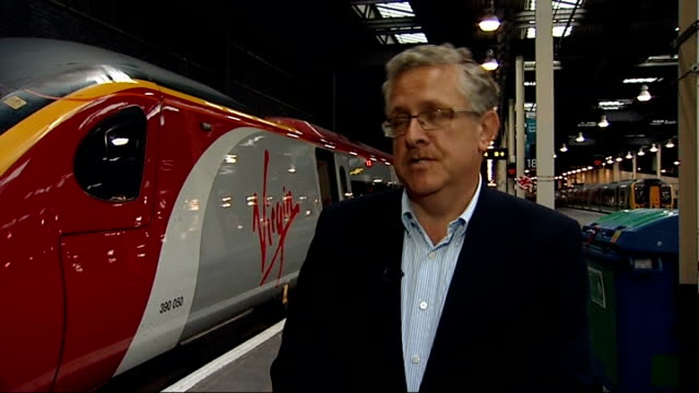 virgin trains loses west coast mainline franchise to firstgroup; london: euston station: int tony collins interview sot - distraught by decision /... - franchising stock videos & royalty-free footage