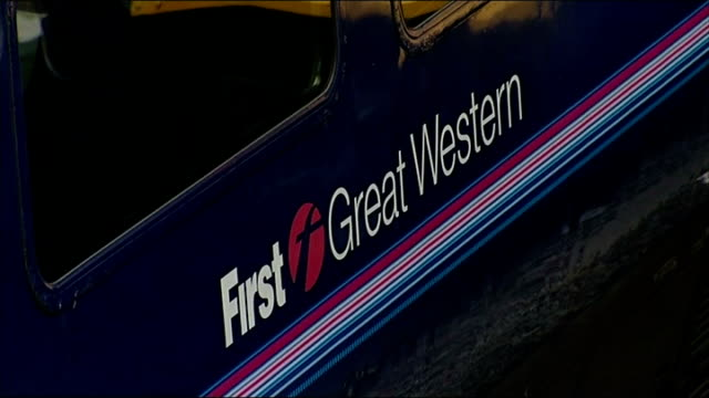 virgin trains loses west coast mainline franchise to firstgroup; paddington: high angle view platforms and trains at paddington station side of first... - franchising stock videos & royalty-free footage