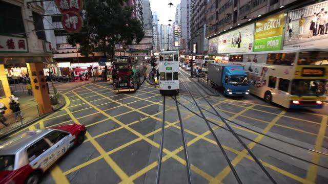 vídeos de stock, filmes e b-roll de ms pov railcar moving through traffic at street / hong kong, china - ponto de vista de bonde