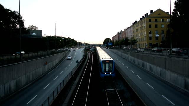 stockvideo's en b-roll-footage met spoorweg in de schemering - forensentrein