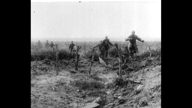 ws railroad carriage bearing artillery passes by / german soldiers run out of trench approach camera as they emerge with hands raised in surrender /... - trench stock videos & royalty-free footage