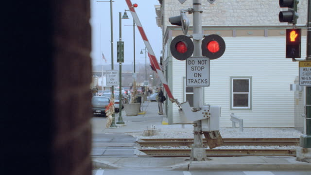 railroad crossing lights flash as the arm lowers. - level crossing stock videos & royalty-free footage
