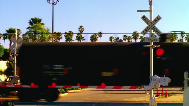 MS Railroad crossing with freight train passing, Santa Barbara, California, USA