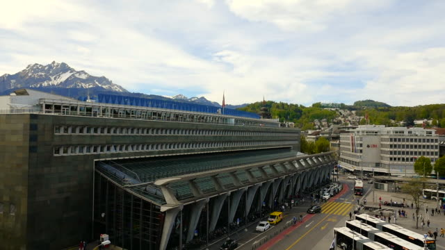 railroad station and mountain in lucerne - 建物入口点の映像素材/bロール