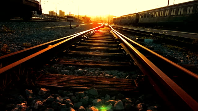 railroad track at sunset - railway track stock videos & royalty-free footage