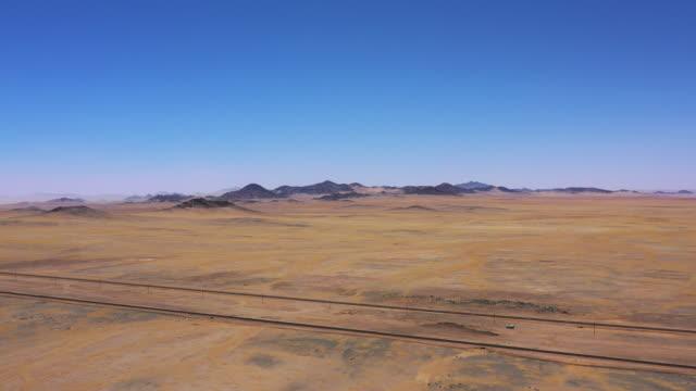 railroad track luderitz and kolmanskop namibia drone 4k video flight - railroad track stock videos & royalty-free footage
