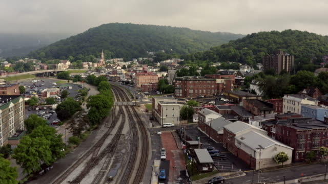 railroad tracks to rail station in small town cumberland maryland - appalachian mountains stock videos & royalty-free footage