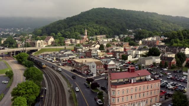 railroad tracks to rail station in small town cumberland maryland - small town stock videos & royalty-free footage