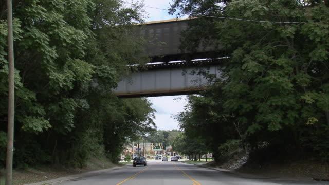 LA Railroad train crossing bridge over town road / Columbia, South Carolina, United States