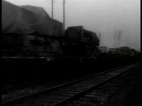 vídeos y material grabado en eventos de stock de railroad train moving on rural tracks angled ws freight train moving up frame dramatization cu male hands placing sticks of dynamite under railroad... - explosivo