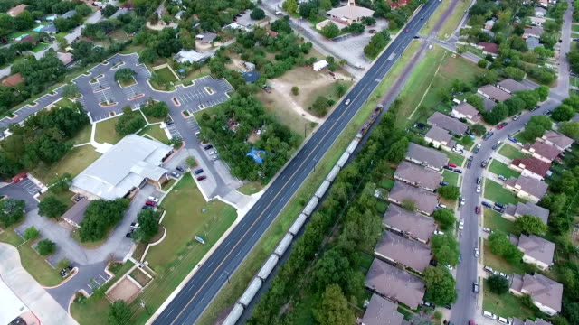 railroad train simple transportation aerial above homes and houses in suburb new modern development in central texas outside of austin, tx - modern rock stock videos & royalty-free footage