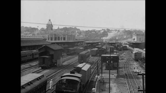 Railroad yard LA MS Electric train passing by WS Electric train moving on railroad tracks