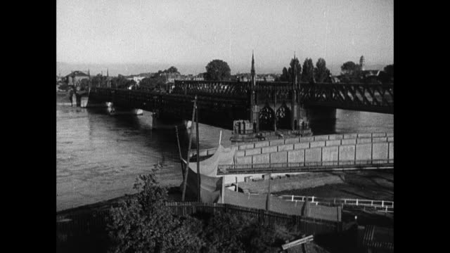montage railway and foot bridges over the rhine to kehl, barbed wire barricade, and military zone sign / strasbourg, france - maginot linie stock-videos und b-roll-filmmaterial