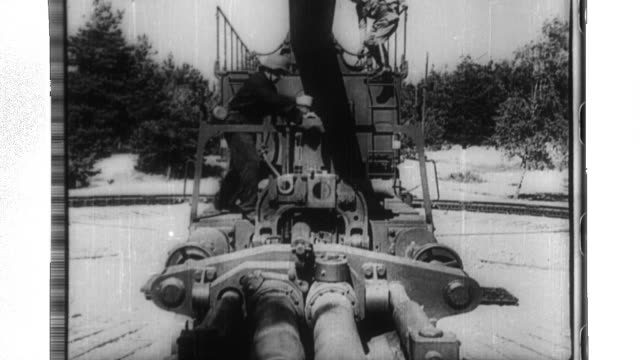 a railway based german artillery piece fires shells across the english chanel toward england - wehrmacht stock-videos und b-roll-filmmaterial