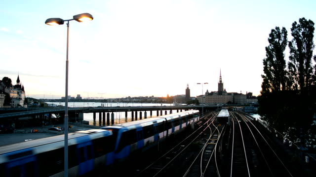 railway bridge in stockholm city - commuter train stock videos & royalty-free footage