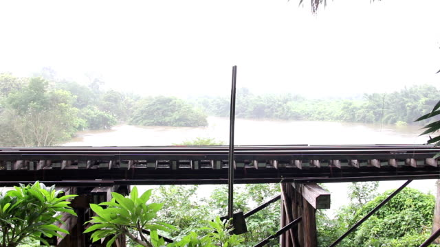 railway bridge near river at raining time - railway bridge stock videos & royalty-free footage