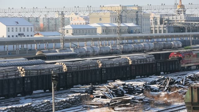 railway carriages full of timber and other resources which imported from russia stop at manzhouli railway station manzhouli city is the largest... - other stock videos and b-roll footage