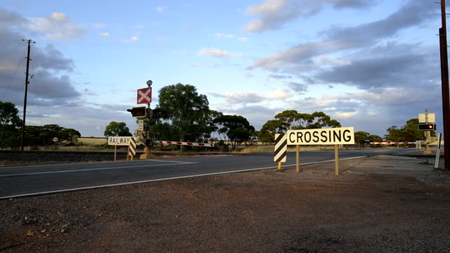 railway crossing between carrabin and bodallin, great eastern highway, western australia - road sign stock videos & royalty-free footage