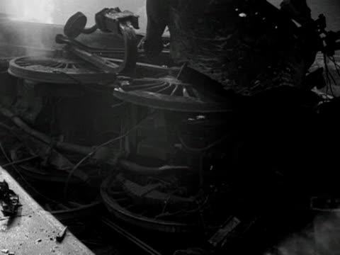 railway engine lies overturned still smoking at harrow and wealdstone railway station after three passenger trains collide. - harrow stock videos & royalty-free footage
