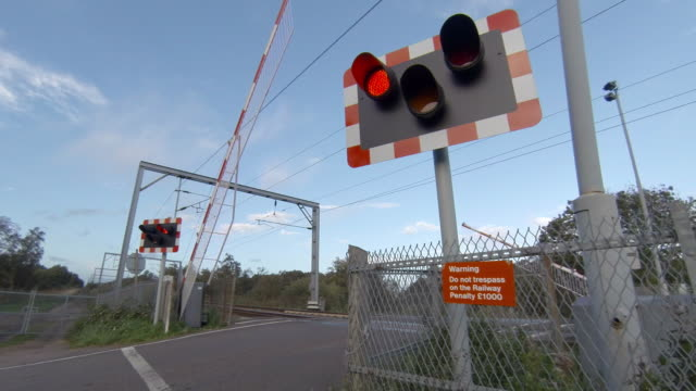 railway level crossing gates closing - chainlink fence stock videos and b-roll footage
