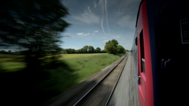railway line alongside red train carriage. - moving past stock videos & royalty-free footage