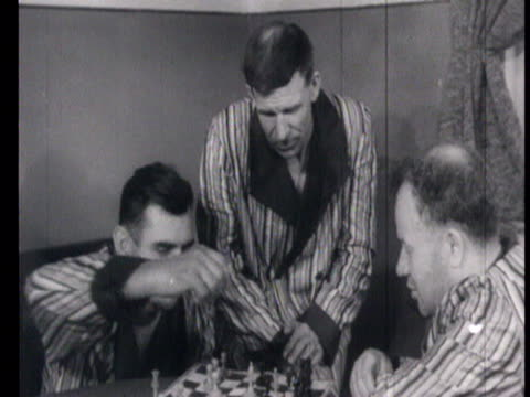 railway men's everyday life in 1940s 1950s railway workers at rest washing in the morning sleeping playing chess / russia audio - 1951 stock videos & royalty-free footage