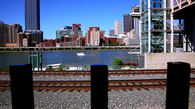 stockvideo's en b-roll-footage met railway opposite the river and downtown - background. - kei