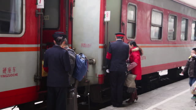 ms railway platform and train attendant checking tickets / baoji, shaanxi, china - transport conductor stock videos & royalty-free footage