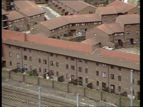 stockvideo's en b-roll-footage met london old bailey kentish town tgv rooftops council flats pull out railway track as train along lr west hampstead ms side train lr past station... - kentish town