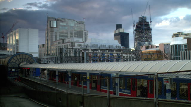 ws, railway station, swiss re tower under construction in background, london, england - 2003 stock videos & royalty-free footage