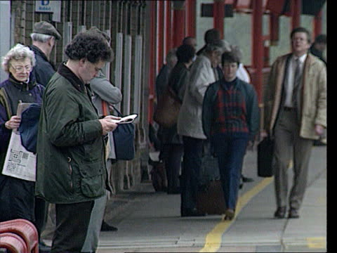 Railway timetables ITN LIB Location Unknown MS Intercity train fast through station PAN RL to BV MS Passengers waiting on platform MS More ditto MS...