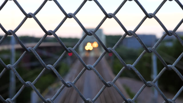 Railway track behind fence
